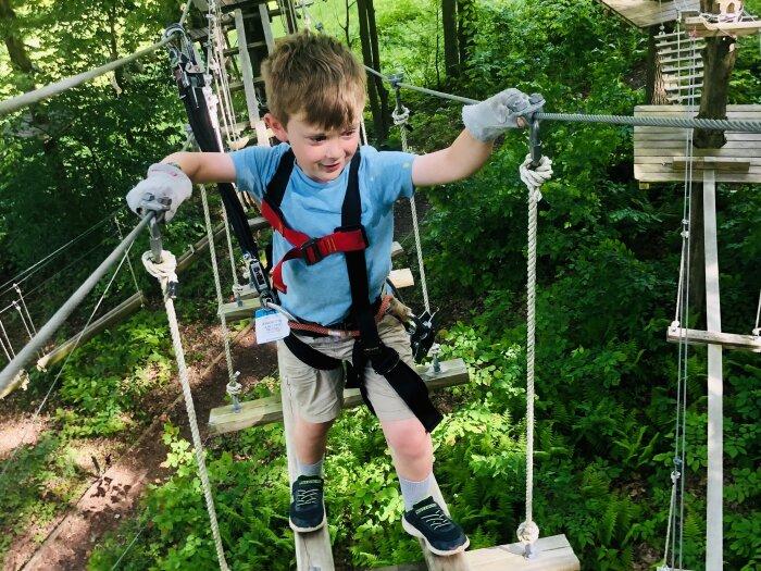 Boy at Peek'n Peak's Aerial Adventure Course